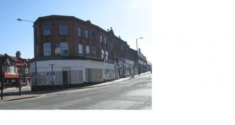 Brick exterior office sits above shops on Wealdstone street corner